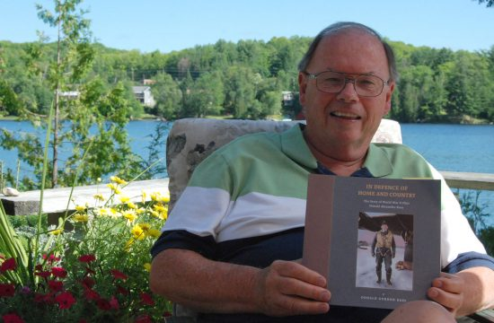Haliburton area cottager Don Ross sits on his deck with a copy of his latest book, In Defence of Home and Country: The Story of World War II Pilot Donald Alexander Ross, about his uncle with whom he shares a name. His uncle died on a mission over Germany in 1945 and Ross recently decided to chronicle his life for the benefit of future generations and to tell the extraordinary story of an ordinary pilot. /JENN WATT Staff